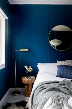 Dark navy blue bedroom brass details. DIY home