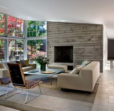 A wood-pressed concrete fireplace in a California home by Turnbull Griffin Haesloop Architects.