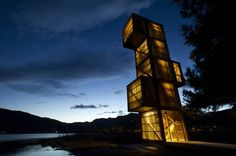 Seljord Watch Tower - Seljord, Norway;  this observation tower has three viewing platforms at different levels;  gaps between the vertical wood slats on the exterior of the tower allow for airflow and light;  designed by Rintala Eggertsson Architects;  photo by Dag Jenssen