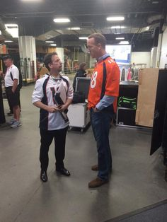 Scott O'Neil, Conductor of the Colorado Symphony, and Peyton Manning