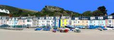 Colourful properties on the promenade Aberdyfi Beach, Wales, UK