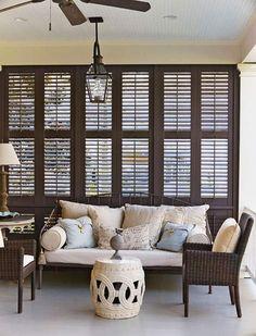 Beadboard ceiling, dark shutters, painted floor. Whitney Stewart, designer. Via Traditional Home.