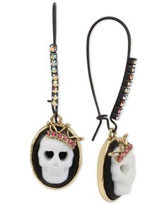 A pair of black and gold cameo earrings made for skull royalty.
