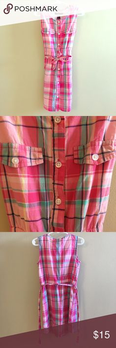 Gap Kids Girl's Pink Plaid Button Down Dress Bright and cheery pink plaid dress! Bright pink, light pink, aqua, navy, and yellow with white buttons. Fabric belt that can be tied around elastic waist. Belt can be removed. Lined. Faux chest pockets; real pockets at sides. Excellent condition - like new! No holes or stains. Size small. *NOTE: In my opinion, this dress runs small and would best fit an XS or size 5.* Bundle with other kids clothes to save! Shell and lining 100% cotton. Gap Kids…