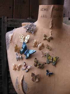 a great way to display your vintage or heirloom broaches, pin 'em on a vintage dress form!