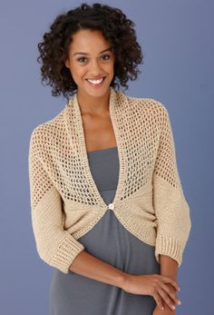 """Glittery Half n Half Shrug - This mesh stitch shrug is an elegant addition to your wardrobe!  SKILL LEVEL:  Intermediate  SIZE: Small, Medium, Large, 1X, 2X   Finished Circumference (front opening) 54 (56, 58, 62, 66)""""  Finished Length 26 (26 1/2, 27, 28, 28 1/2)"""" at center back   Vanna's Choice: 7, 7, 8, 8, 9 pull skeins  E hook or G hook,  one button 3/4"""" dia ,free pdf from Lion Brand"""