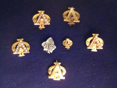 A collection of Alpha Phi badges.