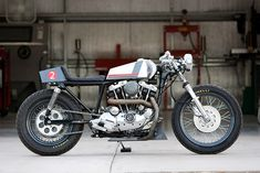 "DP Customs 'Naked Cafe.' 1980 Ironhead Sportster. Aluminum Maico tank. Quantum-port"" symmetrical 2-into-1 exhaust system."