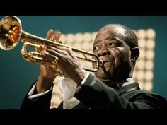 Louis Armstrong - Mini Biography (3:55). Get sensory, hands-on activity ideas for teaching THE TRUMPET OF THE SWAN by E.B. White at http://www.litwitsworkshops.com/free-resources/the-trumpet-of-the-swan/ LitWits makes great books real and fun for kids!
