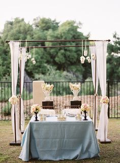 Ceremony arch repurposed into sweetheart table backdrop | In The Now Weddings + Events | Ryan Ray Photography