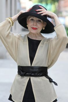 The ladies featured on the Advanced Style blog inspire me so much.  Just look at this beautiful woman named Mrs. Rock. So put together and elegant.  One thing I always notice is that these older ladies know how to accessorize well, and Mrs. Rock is no exception. :)