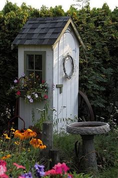 This is the smallest Garden shed I have ever seen, almost to small to be a Outdoor house. There are bird bath and flowers!! Enjoy!!