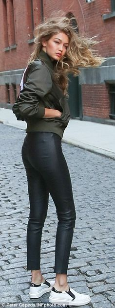 On-trend: Over the racy top, she sported an olive green on-trend jacket featuring a huge H...