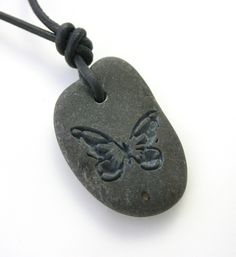 Butterfly Engraved Stone River Rock Necklace. $20.00, via Etsy.