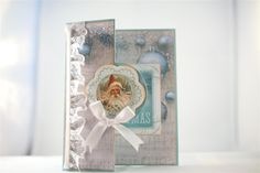 """Kaisercraft Silver Bells paper collection and collectables. Again I have folded the front of my card base ( stampin Up cardstock) back on itself, and decorated with some of the paper from the 6"""" pa..."""