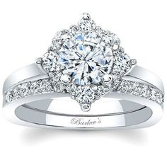 Barkev's 14K White Gold Halo Diamond Engagement Ring with Diamond Wedding Band Set Featuring 0.54 Carats Total Weight Round Cut Diamonds at Ben Garelick Jewelers http://ss1.us/a/t1SPppfP