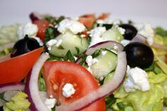 Tuscan Salad ~ Romaine, Crumbled Gorgonzola Cheese, Cucumber, Olives,Tomato & Onion Salad with Basil Vinaigrette.
