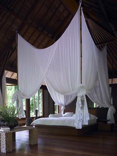 Panchoran Retreat - Ubud, Bali - Indonesia #glamping #huts surrounded by gardens and  a lush river/bamboo tropical landscape.