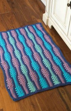 Textured Waves Rug Free Crochet Pattern from Red Heart Yarns