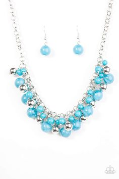 Opaque blue beads trickle from the bottom of a bold silver chain. Infused with classic silver beading, the colorful fringe joins below the collar in a timelessly colorful fashion. Features an adjustable clasp closure. Sold as one individual necklace. Includes one pair of matching earrings.