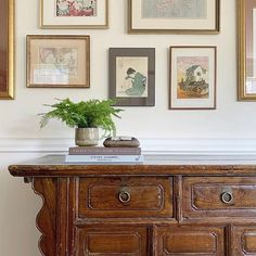 Trim Design Co. | This guide will give you tips and pointers for how to design your own art wall to display a gallery of works. This wall was inspired by the homeowner's collection of Asian art from her travels.   #trimdesignco #artwall #gallerywall