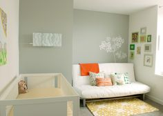 bright and contemporary nursery - good way to merge IKEA futon with the nursery furniture