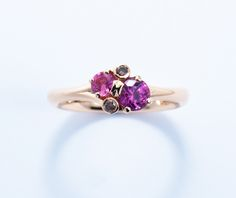 Spring Meadow 18ct red gold ring with pink sapphires and brown diamonds. The asymmetry of this design, coupled with the branching setting, gives it a wholly natural feel. #Fairtrade #Fairtradegold #SpringMeadow #JonDibben #handmadeinsurrey #handmade