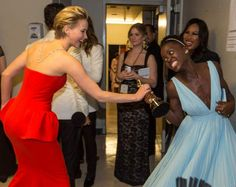 Jennifer Lawrence and Lupita Nyong'o fight over the Oscar on Mar 2, 2014 at the Dolby Theatre