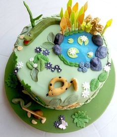 The brief on this cake was: old Gabriel wants an alligator and a snake! So I thought of a swamp cake and my initial inspiration was a cake made by The House of The Rising Cake. This is a light chocolate fondant cake with layers. Chocolate Fondant Cake, Fondant Cakes, Cupcake Cakes, Kid Cakes, Cupcakes, Pond Cake, Snake Cakes, Jungle Cake, Animal Cakes