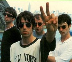 Oasis were an English rock band formed in Manchester in 1991