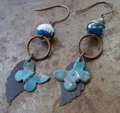 Sweet artisan butterflies in teal flutter along a brass leaf, swaying under light-weight polymer clay beads in a branch design.