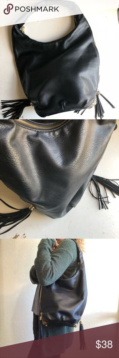 """Lionel vegan leather bucket bag / hobo Lionel Los Angeles / New York black hobo bucket bag. Made from vegan leather, fits easily on shoulder. Base has structure, so purse can stand independently. Side zippers reveal metal mesh material, or zip to conceal. Some wear to bottom of metal mesh - not noticeable when carrying. Vegan leather is in like-new condition , inside is very clean. Bag stands 22"""" high including handle, bag is 10"""" wide. Lionel Bags Hobos"""