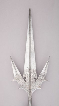 Staff Weapon | Italian | The Met Date:ca. 1550 Culture:Italian Medium:Steel, wood, textile, copper alloy Dimensions:L. 8 ft. 4 in. (254 cm); L. of head 23 1/2 in. (59.7 cm); W. 8 7/8 in. (22.5 cm); Wt. 7 lbs. 6.8 oz. (3367.9 g) Classification:Shafted Weapons Credit Line:John Stoneacre Ellis Collection, Gift of Mrs. Ellis and Augustus Van Horne Ellis, 1896 Accession Number:96.5.13