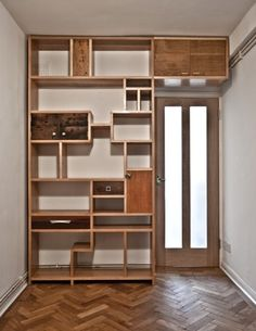 Collaberation with Toby Liberman. Bespoke fitted tetris style shelving unit with reclaimed wooden doors and fixings.