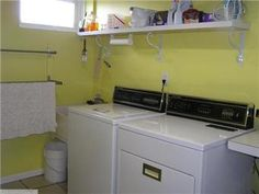 lovely, finished laundry room, tile floor and all