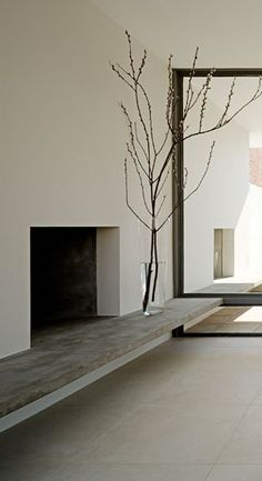 Use a similar concept for an outdoor fireplace - but a half wall instead of full.