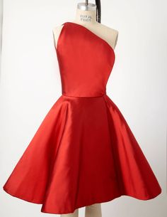 """If the invite says """"cocktail attire"""" we think this Carolyne Roehm one shouldered dress would be perfect!"""
