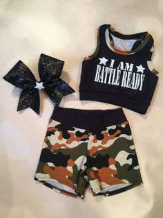 ****AMPt will be taking a short break from March 17th to March 27th. Make sure to place new orders ASAP!*****  Camo Racer Back crop top, shorts and optional matching cheer bow.  Please take note of the sizing chart and measure. My sizes are unique to My product. Just a couple seconds to measure can ensure a proper fit and high satisfaction with this product. Feel free to message about other sizes that may not be listed. Thank You!  SIZE - Approximate childrens US size - Bust - Waist - Hips…