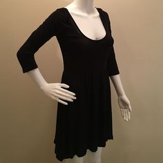 Little black dress from garage Stage. Small. Perfect condition. Black dress. Low neckline. Dips in the back. Three quarter sleeves. Garage Dresses Mini