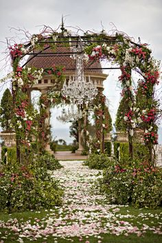 aboutdetailsdetails.com | OC Wedding Planner | Top Wedding Planner | Wedding Ceremony Inspiration | Wedding Ceremony Idea | Garden Ceremony | Vine Archway | Charming and Beautiful | Chandeliers | Flower Petal Aisle