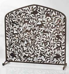 'LA FÔRET', A PATINATED WROUGHT IRON FIRESCREEN BY EDGAR BRANDT, 1925