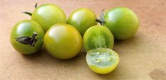 TOMATO GREEN GRAPE: Delicious olive green fruit with a with a refreshing lemon zest are produced in abundance on this compact plant. Harvest in 10-12 weeks, yields 4.9kg/plant.