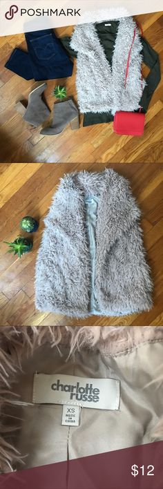 Charlotte Russe Shaggy Vest Charlotte Russe Shaggy Faux Fur Vest, in a Pale Pink. Great addition to any outfit and unbelievably soft. Worn one time, excellent condition. It's an XS but I'm a small-med and it fits me perfectly! Charlotte Russe Jackets & Coats Vests