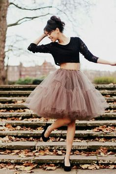 A tulle skirt, black leotard, and pointe shoes with these steps during the fall season