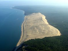 It looks like Europe has started turning into a new sahara desert. The Great Dune of Pyla is the tallest sand dune in Europe. It is located in the Arcachon Bay area in France.    The dune has a volume of about 60,000,000 m³, measuring around 1,640 ft (500 m) wide from east to west and 1,9 miles (3 km) in length from north to south. The dune moves relentlessly towards the interior of the country and gradually covers buildings and roads.