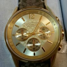 Coach watch, gold face, brown cc band Beautiful watch.   Plastic still on the face of the watch and the back of the watch .  I bought it for my daughter and she didn't like it. The only time it was worn is when I tried it on. No trades Coach Accessories Watches