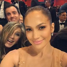 「Photo bombed by my favorite couple Jennifer and Justin #Oscars」