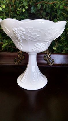 Check out this item in my Etsy shop https://www.etsy.com/listing/225345190/vintage-milk-glass-pedestal-bowl-fall