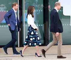 The Duchess showed off her slim legs in a knee length skirt from the high street