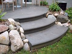 Splayed Trex Composite Deck Stairs Onto Stamped Concrete